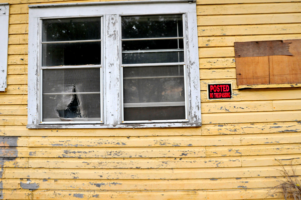 Nearly three years after Hurricane Katrina hit Biloxi, MS, the walls of this house still show flood damage from the storm. Photo by Liliana Rodriguez