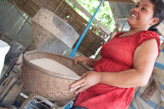 Seng Sreila in June 2008 showing off her rice mill. Photo by Inazio.