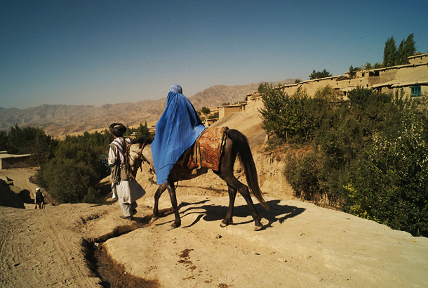 Traveling with her new baby under her burka, this 25-year-old woman is escorted by her father along the rough roads of Badakshan on her way to a health post two hours away to seek help for the bleeding she has been experiencing. There, she learned she has liver damage and may have problems with future deliveries. Photo Credit: Alix Fazzina