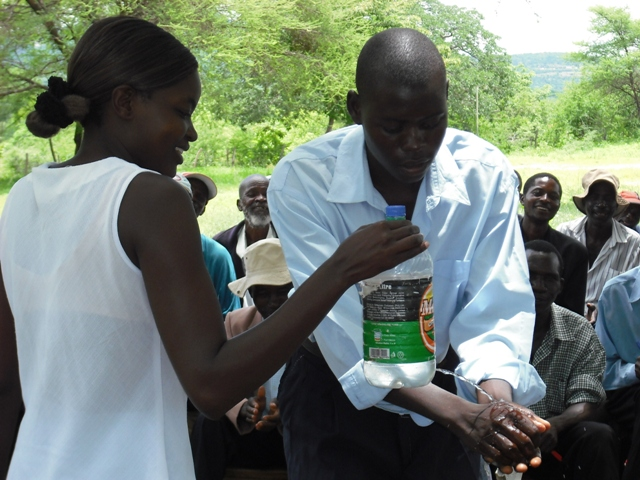 In its second life, a soda bottle becomes a portable hand-washer to fight the spread of cholera in Zimbabwe.