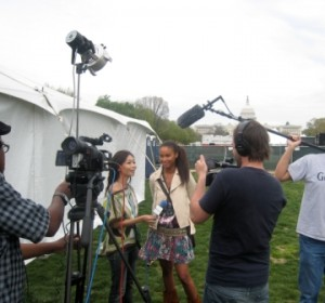 Joy Bryant gives interviews after speaking on the Mall. Photo: Laura Rusu / Oxfam America